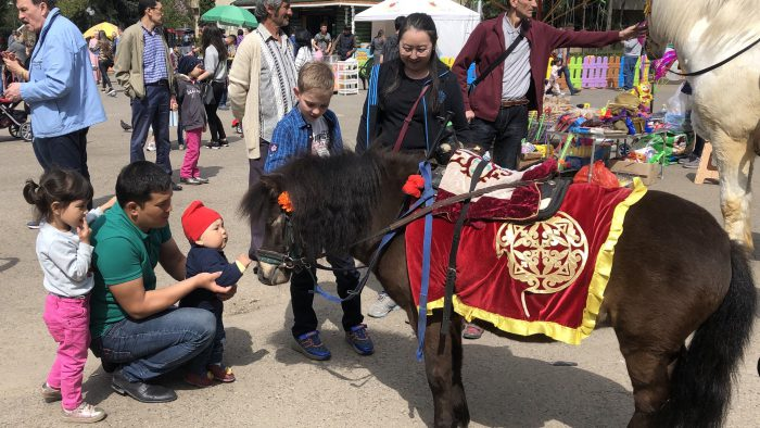 IMG_3507 - Horses and a youngster meeting. Central Asians are fond of horses.